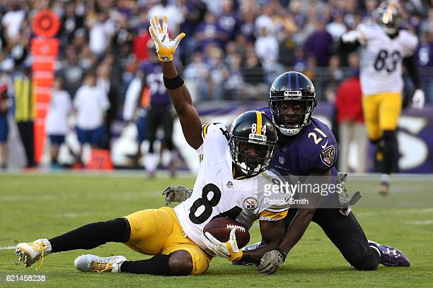 Wide receiver Antonio Brown of the Pittsburgh Steelers celebrates after scoring a fourth quarter touchdown while free safety Lardarius Webb of the...