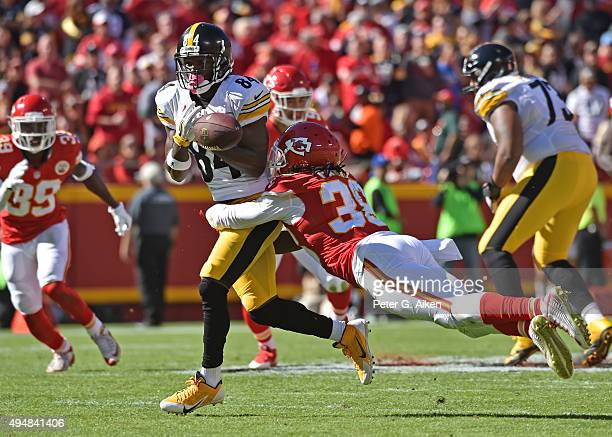 Wide receiver Antonio Brown of the Pittsburgh Steelers losses the ball after getting hit by safety Hussain Abdullah of the Kansas City Chiefs during...