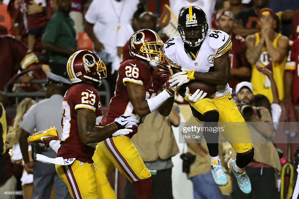 Wide receiver Antonio Brown #84 of the Pittsburgh Steelers scores a second quarter touchdown past cornerback Bashaud Breeland #26 and strong safety DeAngelo Hall #23 of the Washington Redskins at FedExField on September 12, 2016 in Landover, Maryland.