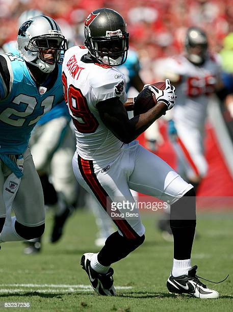 Wide receiver Antonio Bryant of Tampa Bay Buccaneers looks for room to run while avoiding a tackle attempt by cornerback Ken Lucas of the Carolina...