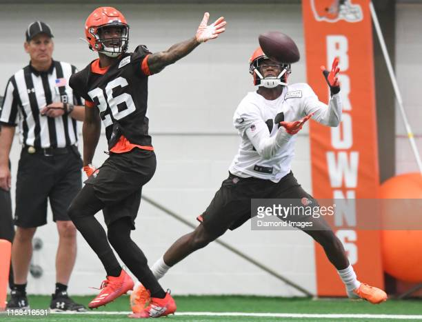 Wide receiver Antonio Callaway of the Cleveland Browns attempts to catch a pass against cornerback Greedy Williams during a mandatory mini camp...