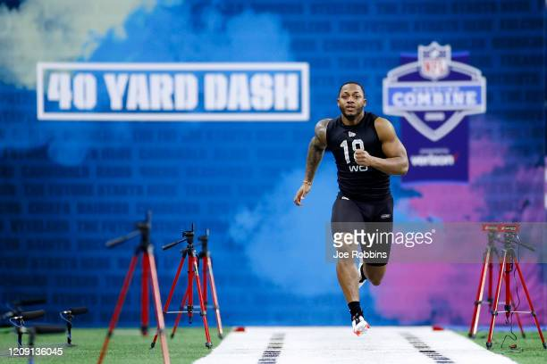 Wide receiver Antonio Gibson of Memphis runs the 40-yard dash during NFL Scouting Combine at Lucas Oil Stadium on February 27, 2020 in Indianapolis,...