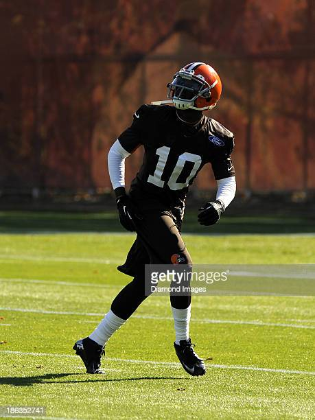 Wide receiver Armanti Edwards of the Cleveland Browns prepares to catch a punt during warm ups prior to practice at the Cleveland Browns training...