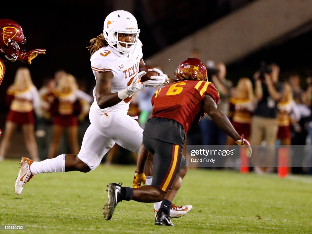Wide receiver Armanti Foreman #3 of the Texas Longhorns rushes for yards past defensive back De'Monte Ruth #6 of the Iowa State Cyclones in the second half of play at Jack Trice Stadium on September 28, 2017 in Ames, Iowa. The Texas Longhorns won 17-7 over the Iowa State Cyclones.