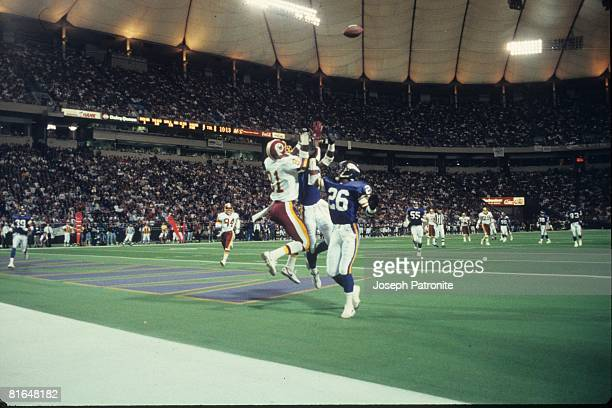 Wide receiver Art Monk of the Washington Redskins leaps for pass on cornerback Audray McMillian on the Minnesota Vikings in the 1992 NFC Wildcard...