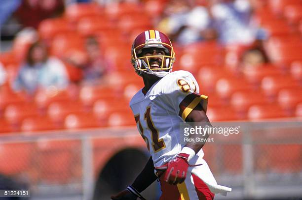 Wide receiver Art Monk of the Washington Redskins runs as he watches the flight of the ball during a game against the Atlanta Falcons at RFK Memorial...