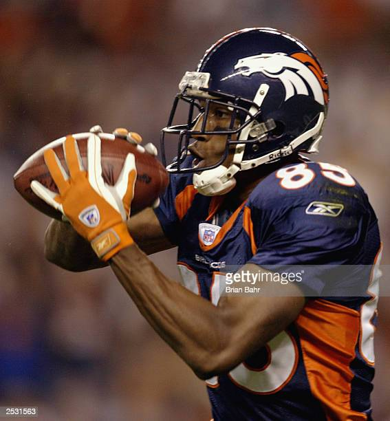 Wide receiver Ashley Lelie of the Denver Broncos catches a touchdown pass against the Oakland Raiders on September 22 2003 at Invesco Field at Mile...