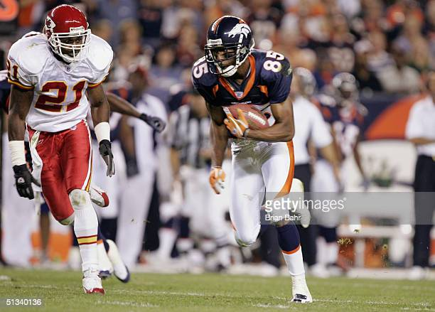 Wide receiver Ashley Lelie of the Denver Broncos evades safety Jerome Woods of the Kansas City Chiefs during the NFL game at Invesco Field on...