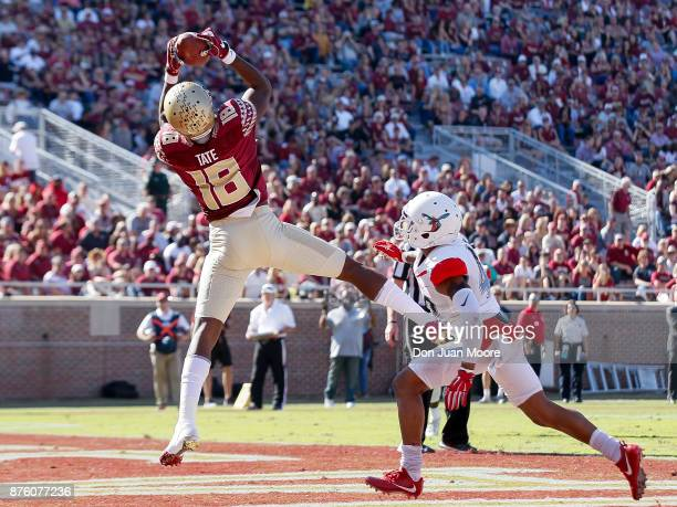 Wide Receiver Auden Tate of the Florida State Seminoles catches a touchdown pass over Cornerback Cartier Wilkins of the Delaware State Hornets during...