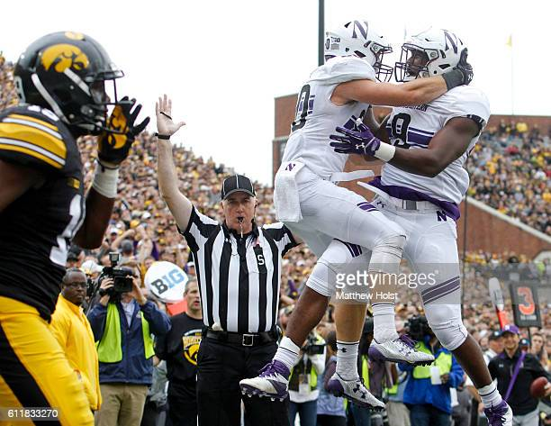 Wide receiver Austin Carr of the Northwestern Wildcats celebrates with split back Garrett Dickerson after a touchdown in the third quarter against...