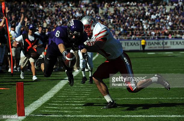 Wide receiver Bart Johnson of the TCU Horned Frogs dives for a touchdown against Clint McPeek of the New Mexico Lobos at Amon G Carter Stadium on...