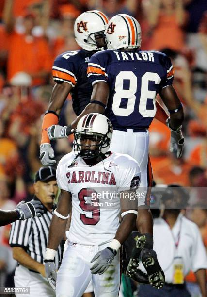 Wide receiver Ben Obomanu of the Auburn Tigers celebrates a touchdown with teammate Courtney Taylor as defensive back Johnathan Joseph of the South...