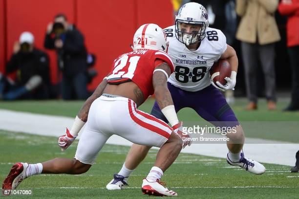 Wide receiver Bennett Skowronek of the Northwestern Wildcats faces off with defensive back Lamar Jackson of the Nebraska Cornhuskers at Memorial...