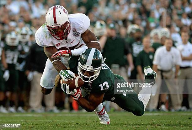 Wide receiver Bennie Fowler of the Michigan State Spartans is unable to make a catch against the Stanford Cardinal in the third quarter of the 100th...