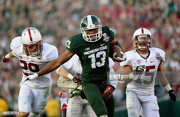Wide receiver Bennie Fowler of the Michigan State Spartans makes a 60yard catch against the Stanford Cardinal in the third quarter of the 100th Rose...