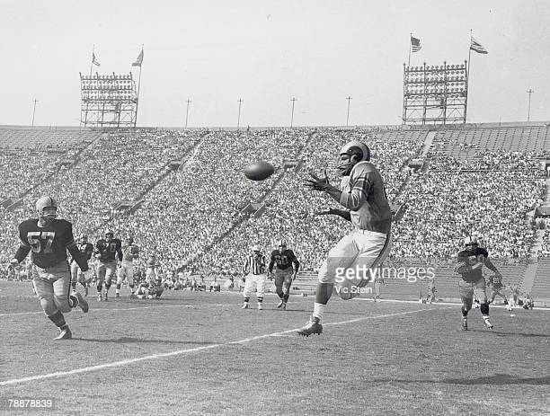 Wide receiver Bob Boyd of the Los Angeles Rams goes airborne to catch a pass behind linebacker Dick Flanagan of the Pittsburgh Steelers during a game...