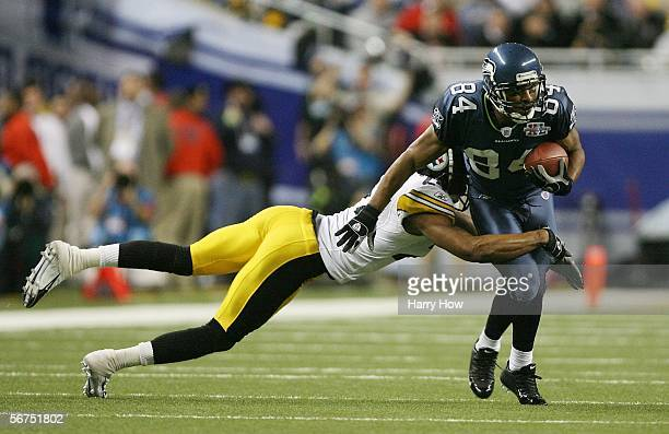 Wide receiver Bobby Engram of the Seattle Seahawks catches a pass before being tackled by Ike Taylor of the Pittsburgh Steelers during the first...
