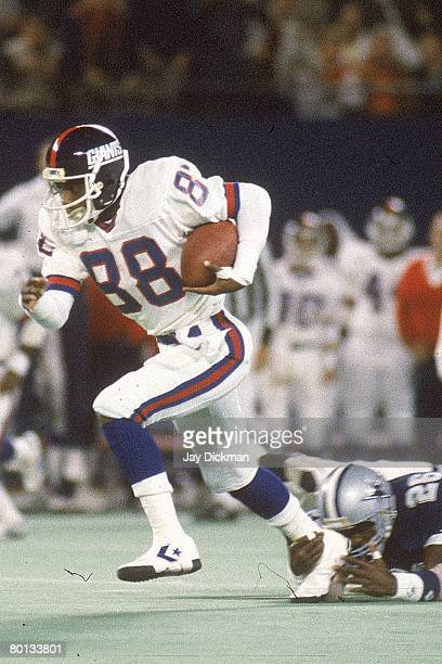 Wide receiver Bobby Johnson of the New York Giants runs away from defensive back Michael Downs of the Dallas Cowboys at Giants Stadium on October 6...
