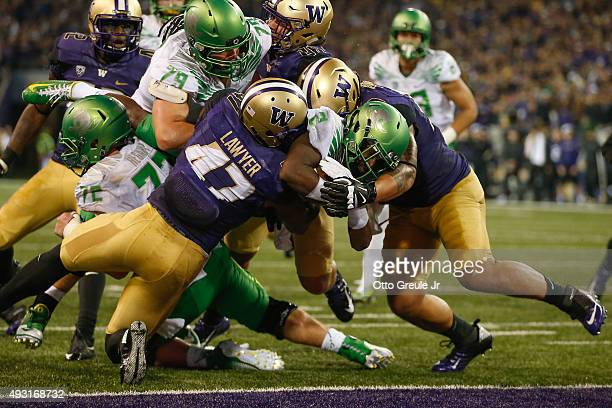 Wide receiver Bralon Addison of the Oregon Ducks rushes for a touchdown against the Washington Huskies on October 17 2015 at Husky Stadium in Seattle...