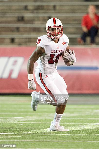 Wide receiver Bra'Lon Cherry of the North Carolina State Wolfpack carries the ball downfield during their game against the South Alabama Jaguars on...