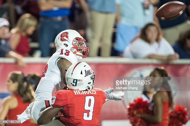 Wide receiver Bra'Lon Cherry of the North Carolina State Wolfpack attempts to catch a pass in front of cornerback Jeremy Reaves of the South Alabama...