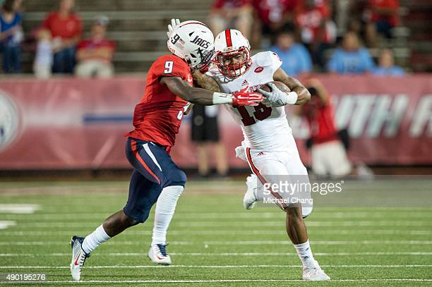 Wide receiver Bra'Lon Cherry of the North Carolina State Wolfpack attempts to avoid a tackle by Jeremy Reaves of the South Alabama Jaguars on...