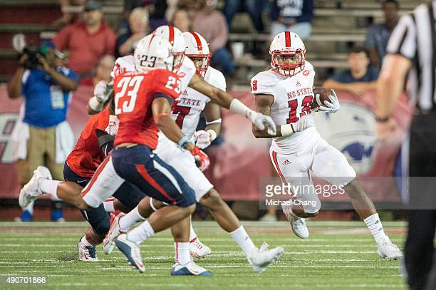 Wide receiver Bra'Lon Cherry of the North Carolina State Wolfpack looks to maneuver by safety Roman Buchanan of the South Alabama Jaguars on...