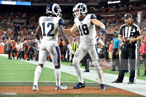 wide receiver Brandin Cooks celebrates with teammate wide receiver Cooper Kupp of the Los Angeles Rams after Kupp scored during the fourth quarter...