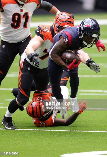 Wide receiver Brandin Cooks of the Houston Texans is tackled by defensive end Margus Hunt of the Cincinnati Bengals during the second quarter of the...