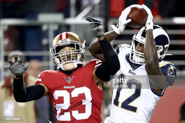 Wide receiver Brandin Cooks of the Los Angeles Rams catches a touchdown over cornerback Ahkello Witherspoon of the San Francisco 49ers in the first...