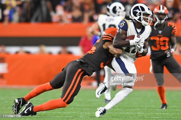 Wide receiver Brandin Cooks of the Los Angeles Rams catches a pass against defensive back Jermaine Whitehead of the Cleveland Browns in the first...