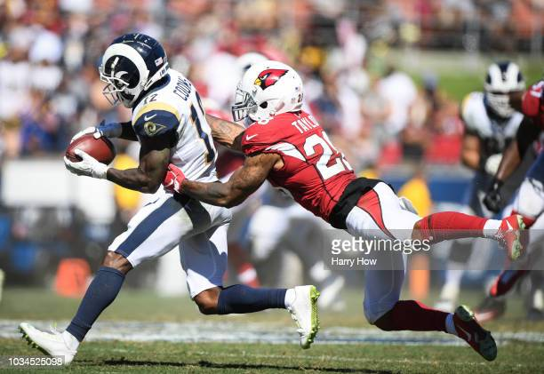 Wide receiver Brandin Cooks of the Los Angeles Rams makes a catch for first down in front of defensive back Jamar Taylor of the Arizona Cardinals in...