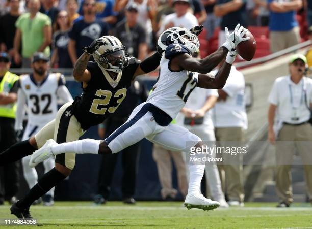 Wide receiver Brandin Cooks of the Los Angeles Rams makes a catch from quarterback Jared Goff in front of cornerback Marshon Lattimore of the New...