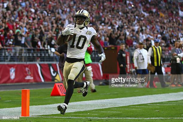 Wide receiver Brandin Cooks of the New Orleans Saints scores on a 45 yard touchdown reception against the Arizona Cardinals during the second quarter...