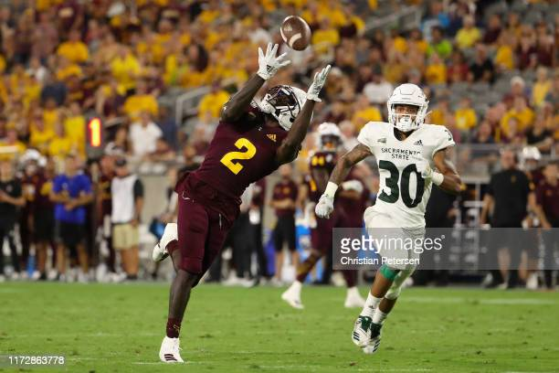 Wide receiver Brandon Aiyuk of the Arizona State Sun Devils catches a 52 yard reception ahead of defensive back Allen Perryman of the Sacramento...