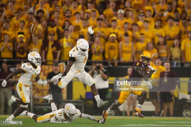 Wide receiver Brandon Aiyuk of the Arizona State Sun Devils runs with the football ahead of linebacker Cepeda Phillips and cornerback Keith Sherald...