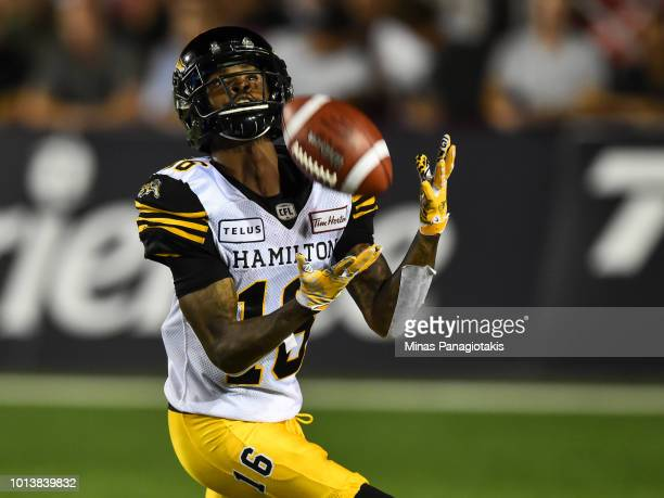Wide receiver Brandon Banks of the Hamilton TigerCats prepares to catch the ball against the Montreal Alouettes during the CFL game at Percival...