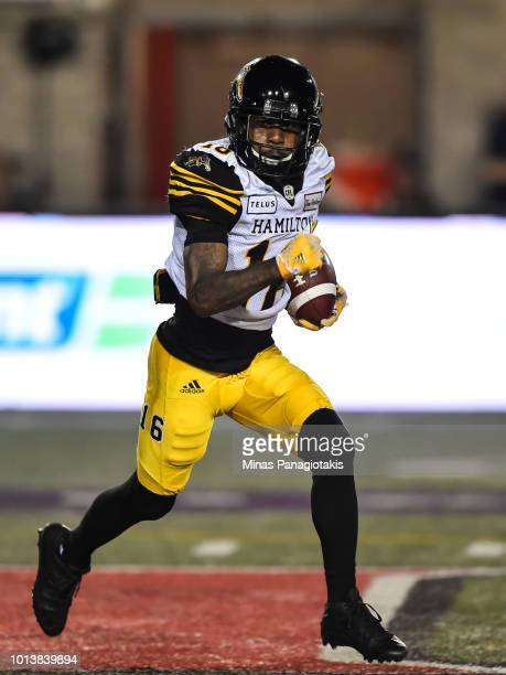Wide receiver Brandon Banks of the Hamilton TigerCats runs with the ball against the Montreal Alouettes during the CFL game at Percival Molson...