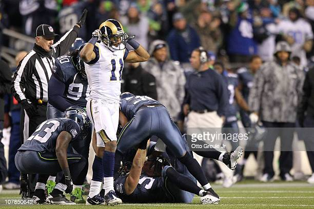 Wide receiver Brandon Gibson of the St Louis Rams reacts after the ball was intercepted by Will Herring of the Seattle Seahawks in the fourth quarter...