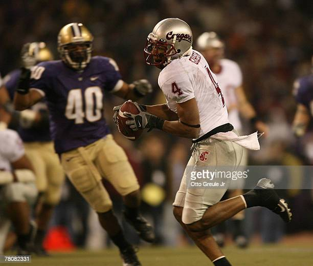 Wide receiver Brandon Gibson of the Washington State Cougars makes a 40 yard touchdown in the second half against the Washington Huskies at Husky...