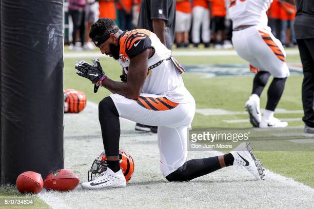 Wide Receiver Brandon LaFell of the Cincinnati Bengals takes a knee and pray in front of the field post before the game against the Jacksonville...