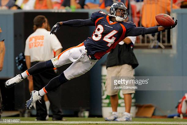 Wide receiver Brandon Lloyd of the Denver Broncos lays out but is unable to haul in a pass during the first half against the Buffalo Bills at Sports...