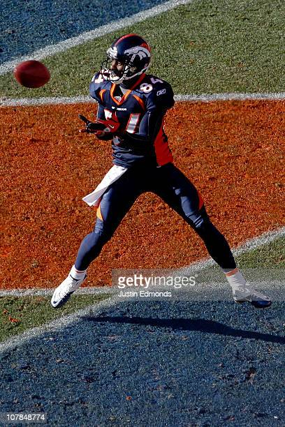 Wide receiver Brandon Lloyd of the Denver Broncos makes a touchdown reception against the San Diego Chargers during the first quarter at INVESCO...