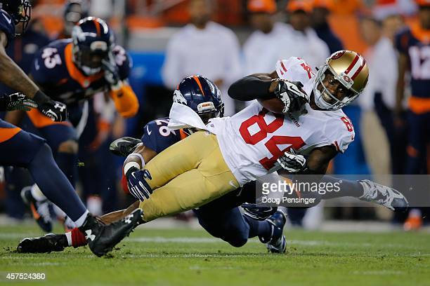Wide receiver Brandon Lloyd of the San Francisco 49ers is tackled after a 37 yard reception in the second quarter of a game against the Denver...