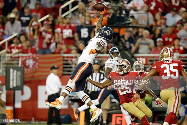 Wide receiver Brandon Marshall of the Chicago Bears catches a touchdown pass during the second quarter of a game against the San Francisco 49ers at...