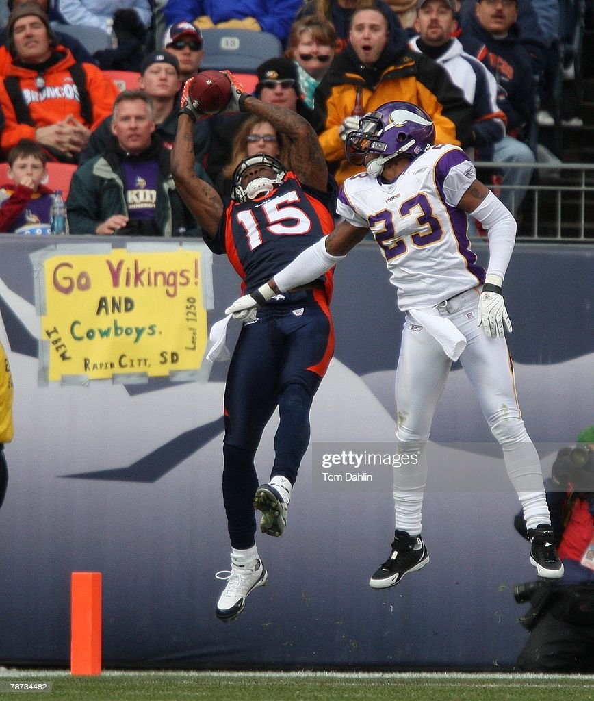 Wide receiver Brandon Marshall #15 of the Denver Broncos makes a touchdown catch as cornerback Cedric Griffin #23 of the Minnesota Vikings defends at an NFL game at Invesco Field at Mile High, on December 30, 2007 in Denver, Colorado.