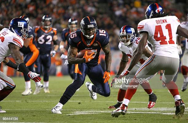 Wide receiver Brandon Marshall of the Denver Broncos makes a pass reception before being corralled by Aaron Rouse Terrell Thomas and CC Brown of the...