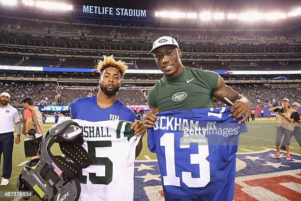 Wide Receiver Brandon Marshall of the New York Jets and Wide Receiver Odell Beckham Jr #13 the New York Giants exchange jerseys at MetLife Stadium on...