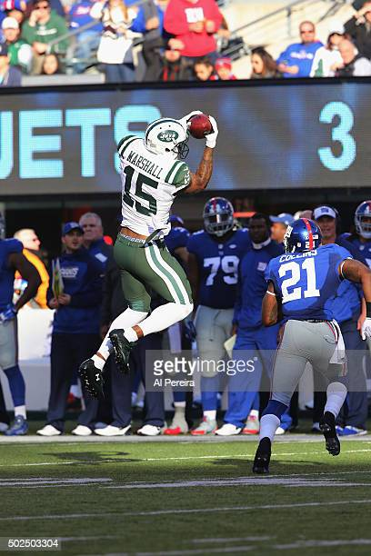 Wide Receiver Brandon Marshall of the New York Jets has a long gain against the New York Giants at MetLife Stadium on December 6 2015 in East...