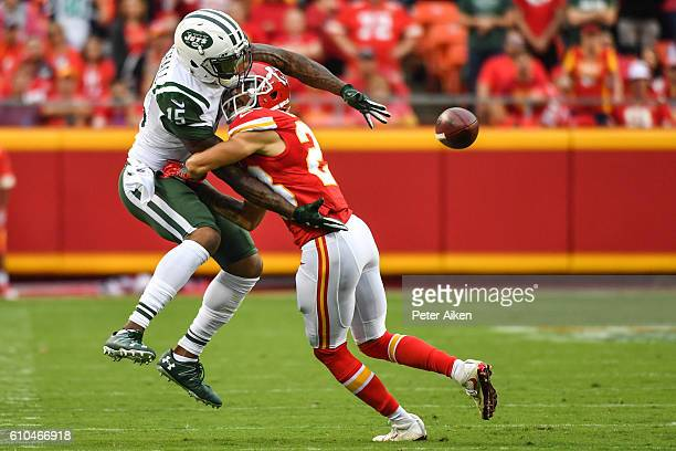 Wide receiver Brandon Marshall of the New York Jets trys to make a catch through cornerback Phillip Gaines of the Kansas City Chiefs at Arrowhead...